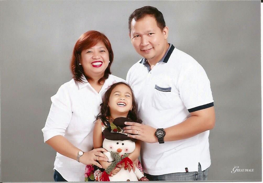 A studio photoshoot of an adoptive family