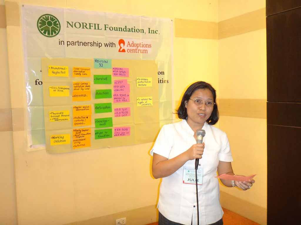 A participant sharing her insights during a workshop