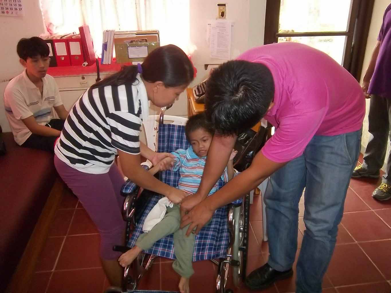 Assisting a child in his wheelchair