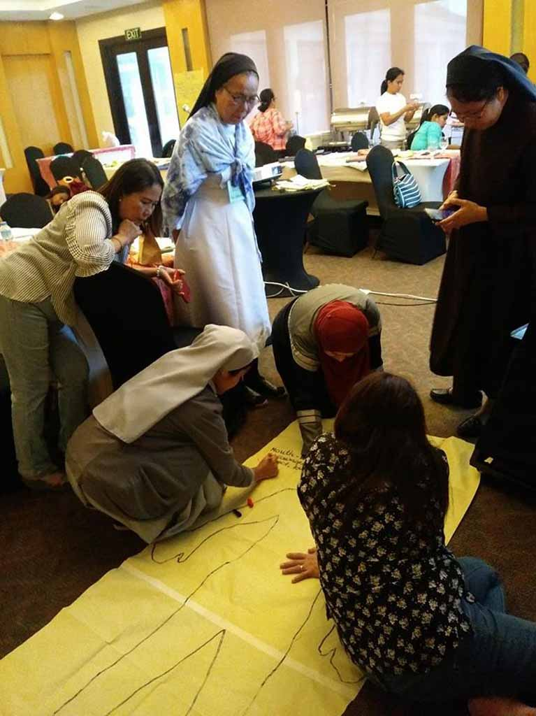 Participants working together in a group activity