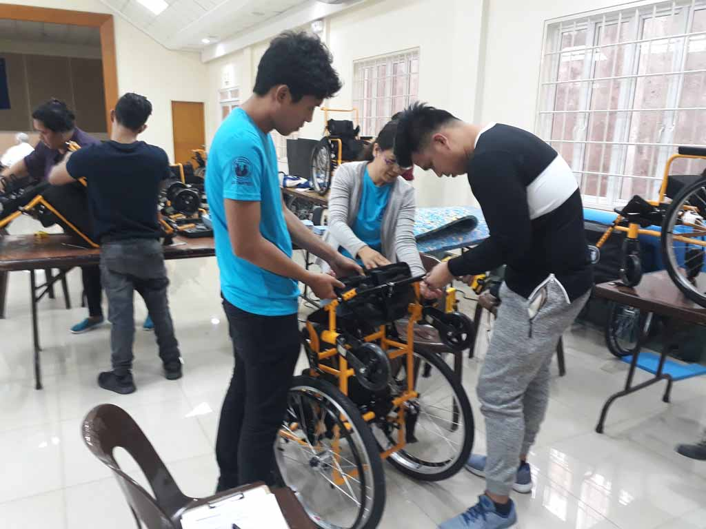 Partners fixing the adjustable wheelchair