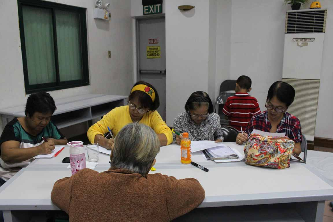 foster parents writing during a training
