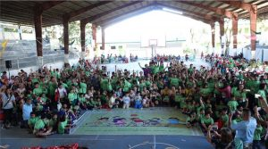 Friendship Games 2018 shot of all the participants wearing green event shirt at the basketball court