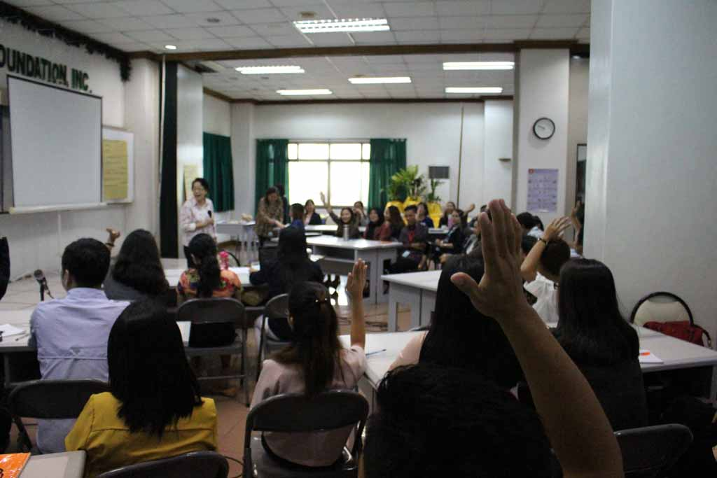 NORFIL Founder Miss Angela Pangan speaking in front of the staff during the NORFIL Staff Development