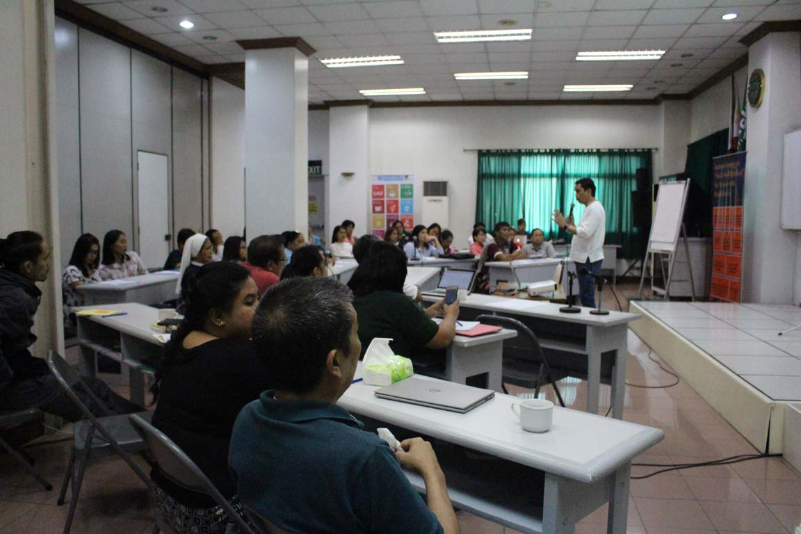A speaker addressing the audience during a training at the NORFIL Training Center