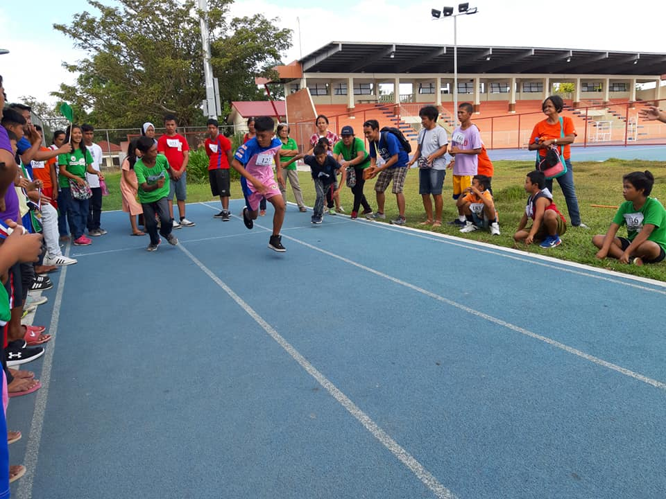 A racing competition during the mini-olympics for children with disabilities